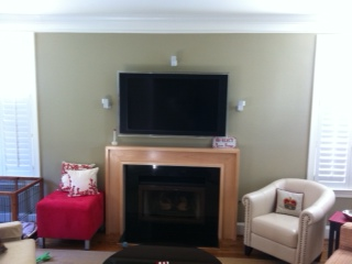 wall-mount t.v. installation with surround sound